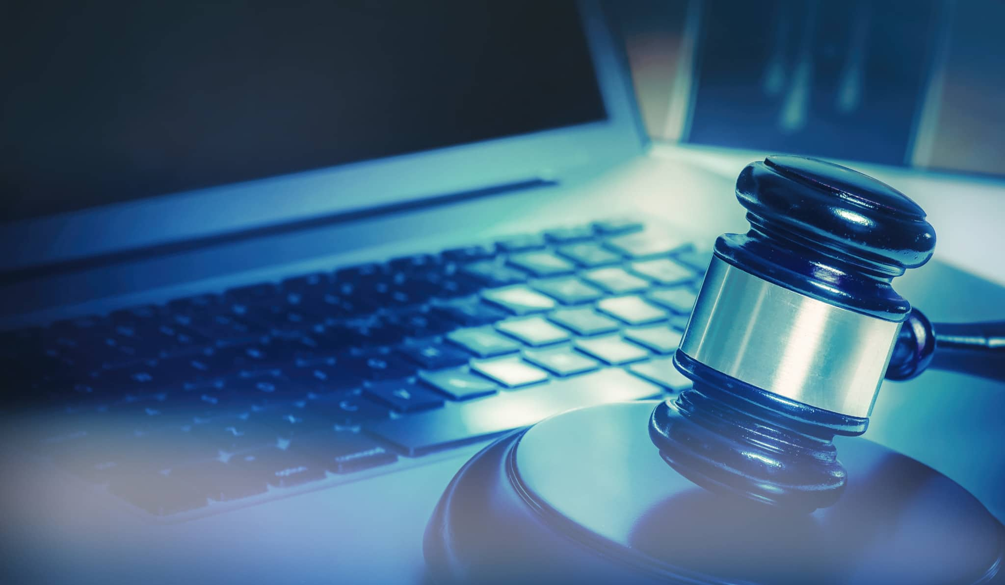 This image shows a gavel and a laptop as cybersecurity is important for law firms.